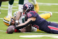 Houston Texans wide receiver Will Fuller V (15) and Green Bay Packers cornerback Jaire Alexander reach for a loose ball during the first half of an NFL football game Sunday, Oct. 25, 2020, in Houston. (AP Photo/Sam Craft)