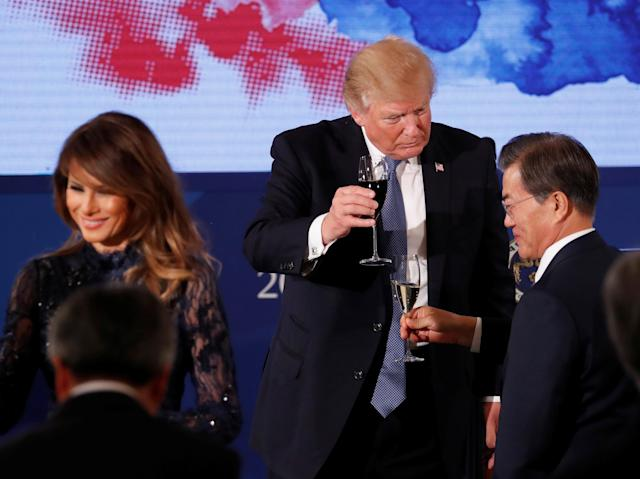 <p>President Donald Trump and South Korea's President Moon Jae-in share a toast during a state dinner in his honor at the Blue House in Seoul, South Korea, Nov. 7, 2017. (Photo: Jonathan Ernst/Reuters) </p>