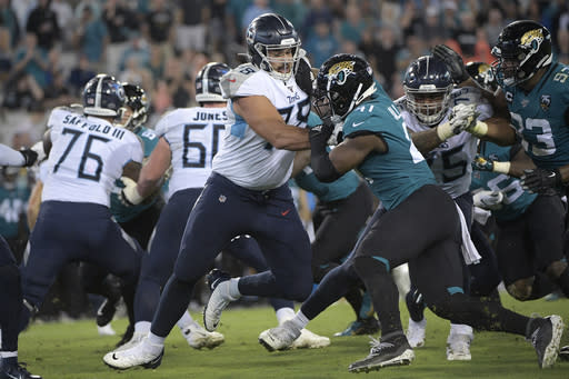 FILE - In this Sept. 19, 2019, file photo, Tennessee Titans offensive tackle Jack Conklin (78) blocks Jacksonville Jaguars defensive end Josh Allen (41) during the first half of an NFL football game in Jacksonville, Fla. Free agent Conklin has agreed to a three-year, $42 million contract with the Cleveland Browns, his agent Drew Rosenhaus told The Associated Press. (AP Photo/Phelan M. Ebenhack, File)