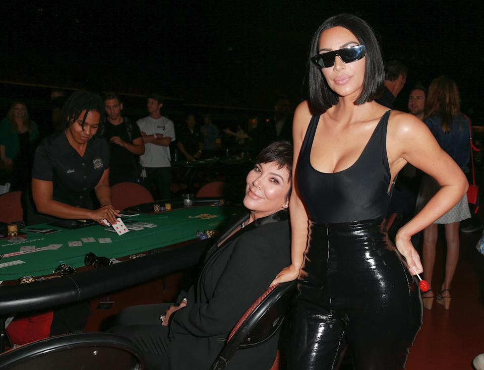 Kim Kardashian showed off her trim figure at the If Only charity poker tournament Sunday. (Photo: Rich Fury/Getty Images)