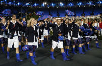 FILE - Athletes from Czech Republic parade during the Opening Ceremony at the Summer Olympics on July 27, 2012, in London. Olympic gear makes for lively social media fodder, starting with the hours-long Parade of Nations. The year's wait due to the pandemic has given enthusiasts extra time to ponder what they love or hate. Shown are the country's loud umbrellas and neon blue Wellington boots. (AP Photo/Matt Dunham, File)
