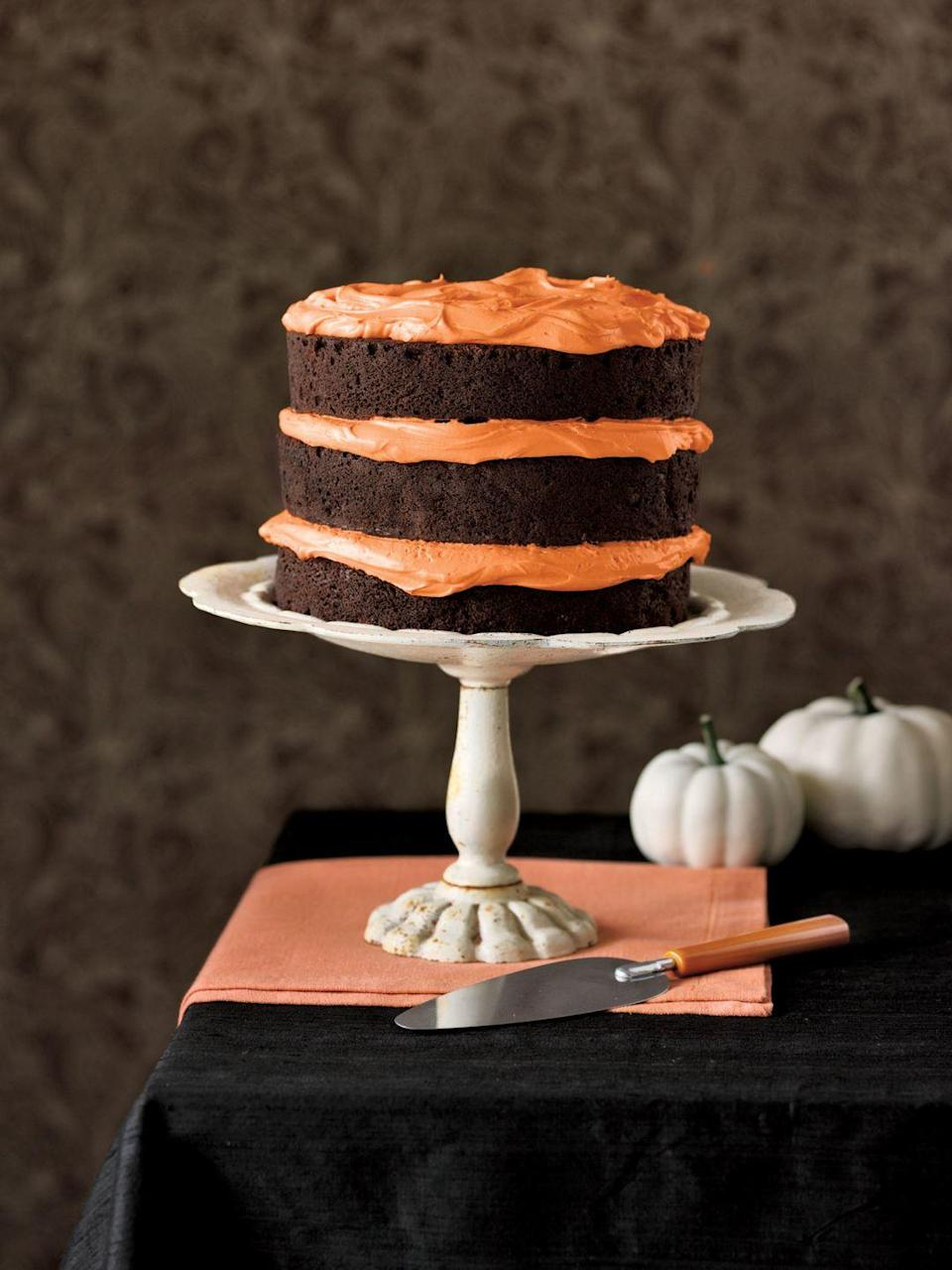 """<p>Give the naked cake trend an orange and black twist for Halloween.</p><p><em><a href=""""https://www.goodhousekeeping.com/food-recipes/a5721/chocolate-pumpkin-cake-cupcakes-3922/"""" rel=""""nofollow noopener"""" target=""""_blank"""" data-ylk=""""slk:Get the recipe for Chocolate Pumpkin Cake »"""" class=""""link rapid-noclick-resp"""">Get the recipe for Chocolate Pumpkin Cake »</a></em> </p>"""