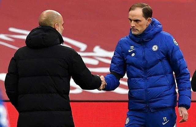 Manchester City manager Pep Guardiola, left, will meet Chelsea manager Thomas Tuchel in the Champions League final