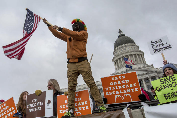 """<span class=""""s1"""">Protesters gather at the Utah State Capitol where President Trump speaks after drastically reducing the size of a Utah national monument. (Photo: Benjamin Zack/Standard-Examiner via AP)</span>"""