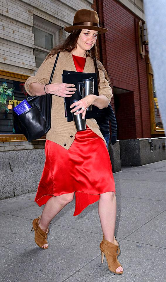 """Katie Holmes looked like a hot mess from head to toe while out and about  in Manhattan on Tuesday afternoon. The actress -- who typically looks  somewhat pulled together -- hit the pavement in a mismatched outfit that  featured a chocolate-brown fedora, grandpa-like cardigan, wrinkled red  sheath, and suede peep-toe booties. We're too distracted to decide which  element is most egregious, so you make the call. Discuss. (3/27/2012)<br> <br> <a target=""""_blank"""" href=""""http://bit.ly/lifeontheMlist"""">Follow What Were They Thinking?! creator, Matt Whitfield, on Twitter!</a>"""