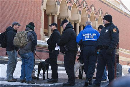 State and local police respond to reports of explosives at Harvard University in Cambridge, Massachusetts, December 16, 2013. REUTERS/Dominick Reuter