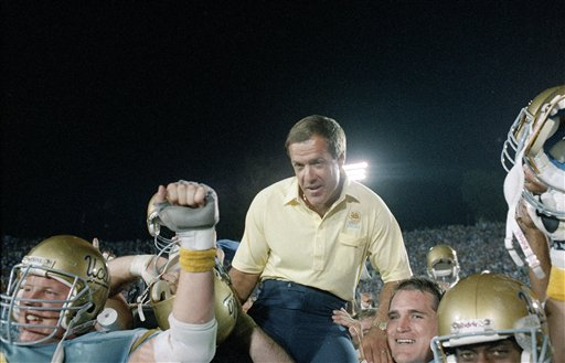 UCLA coach Terry Donahue is carried off the field following his 100th win as Bruins coach.