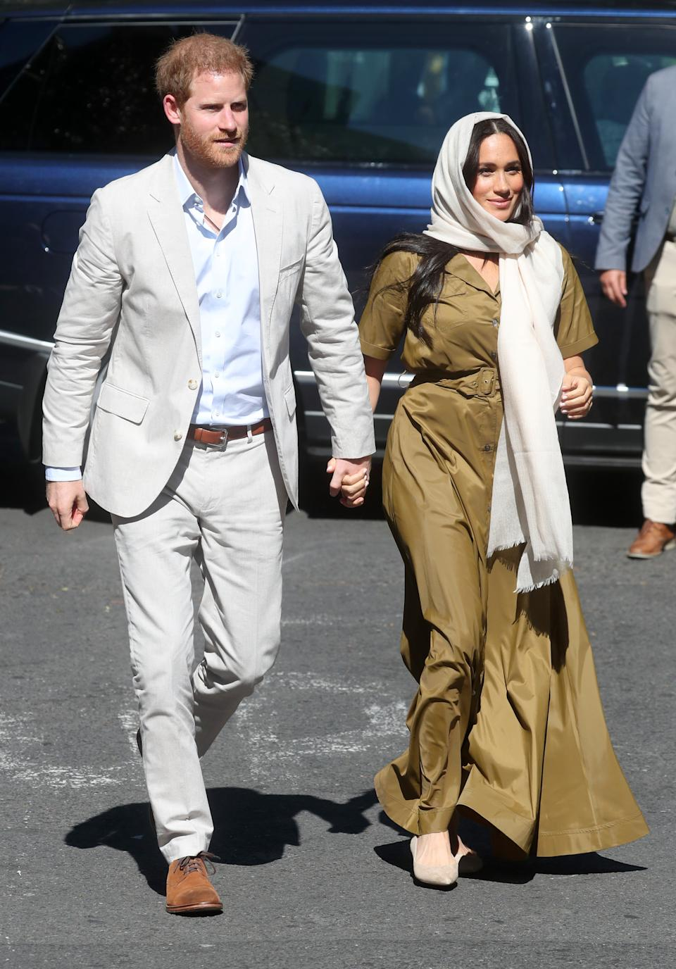 The Duchess of Sussex dressed respectfully in a cream head scarf and khaki maxi dress for a visit to South Africa's oldest mosque on day two of the tour. <em>[Photo: Getty]</em>