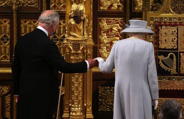 The Queen arrives with the Prince of Wales to deliver the speech