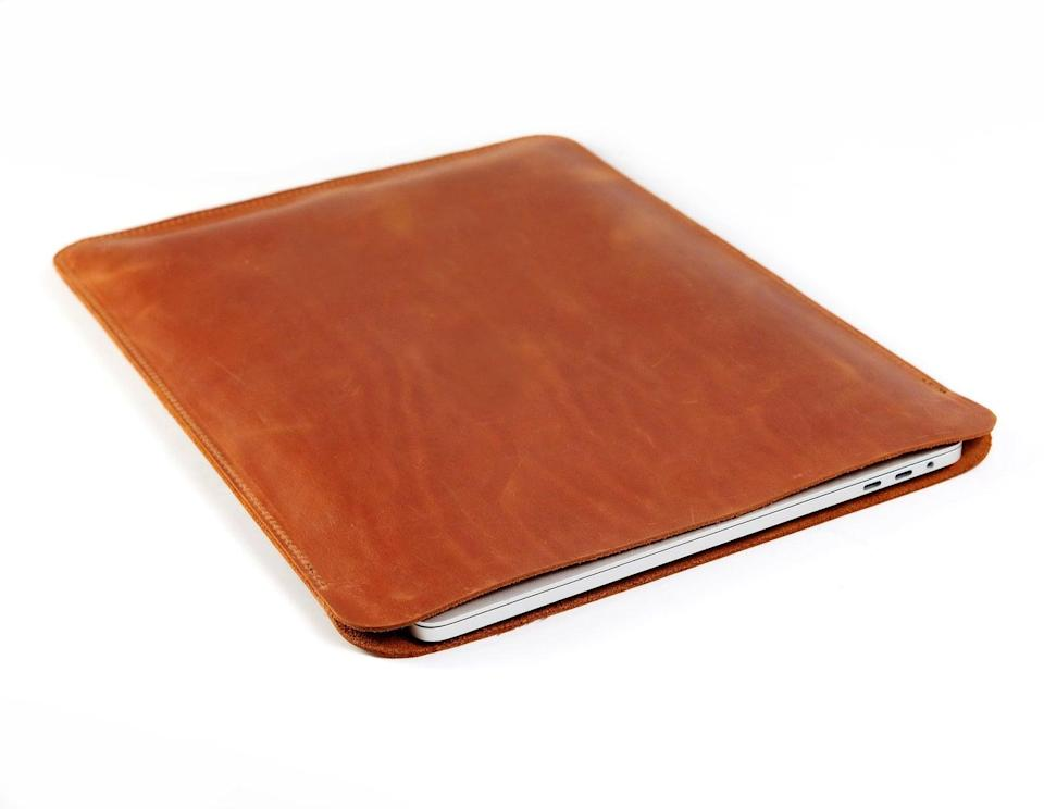 """<br><br><strong>BoomLeatherGoods</strong> Personalized Laptop Sleeve, $, available at <a href=""""https://go.skimresources.com/?id=30283X879131&url=https%3A%2F%2Fwww.etsy.com%2Flisting%2F760498620%2Flaptop-case-personalized-laptop-sleeve"""" rel=""""nofollow noopener"""" target=""""_blank"""" data-ylk=""""slk:Etsy"""" class=""""link rapid-noclick-resp"""">Etsy</a>"""
