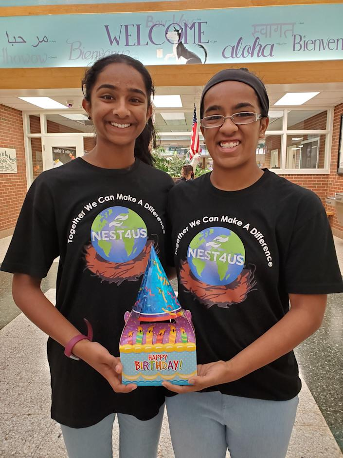 "Shreyaa Venkat, 17, (right) and Esha Venkat, 14, have been creating their signature ""Blessing Bags"" as well as their ""Birthday in a Box"" for kids in the community. (Courtesy of NEST4US)"
