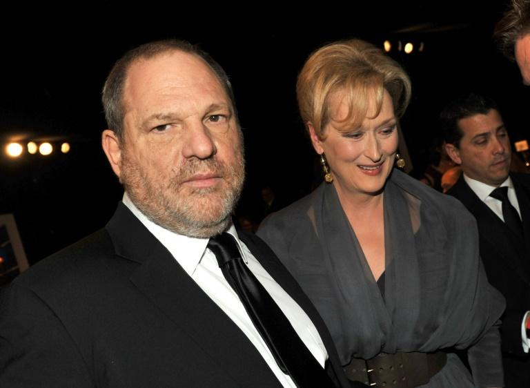 Harvey Weinstein pictured at the 18th Annual Screen Actors Guild Awards in 2012 with actress Meryl Streep, who famously called him 'God' (AFP Photo/KEVIN WINTER)