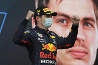 Red Bull driver Max Verstappen of the Netherlands celebrates on podium after winning the Emilia Romagna Formula One Grand Prix, at the Imola racetrack, Italy, Sunday, April 18, 2021. (AP Photo/Luca Bruno)
