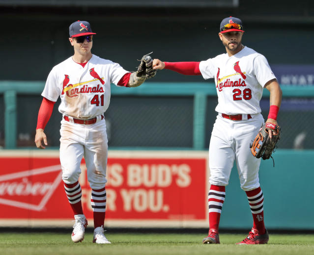 St. Louis Cardinals' Tyler O'Neill (41) and Tommy Pham (28) celebrate following a baseball game against the Philadelphia Phillies, Sunday, May 20, 2018, in St. Louis. (AP Photo/Jeff Roberson)