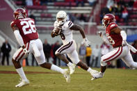 FILE - In this Nov. 2, 2019, file photo, Mississippi State running back Kylin Hill (8) tries to get past Arkansas defenders Micahh Smith (26) and Andrew Parker (28) as he runs for a gain during the second half of an NCAA college football game, in Fayetteville, Ark. Hill was selected to The Associated Press All-Southeastern Conference football team, Monday, Dec. 9, 2019.(AP Photo/Michael Woods, FIle)