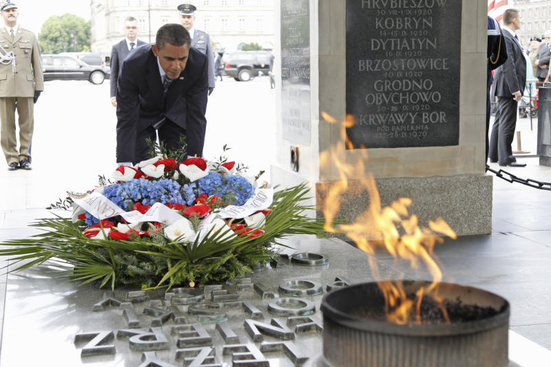 President Barack Obama lays a wreath at the Tomb of the Unknown Soldier in Warsaw, Poland, Friday, May 27, 2011. (AP Photo/Charles Dharapak)