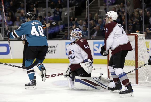 Colorado Avalanche goaltender Jonathan Bernier, center, reacts after giving up a goal to San Jose Sharks' Justin Braun, not seen, during the first period of an NHL hockey game Thursday, April 5, 2018, in San Jose, Calif. (AP Photo/Marcio Jose Sanchez)