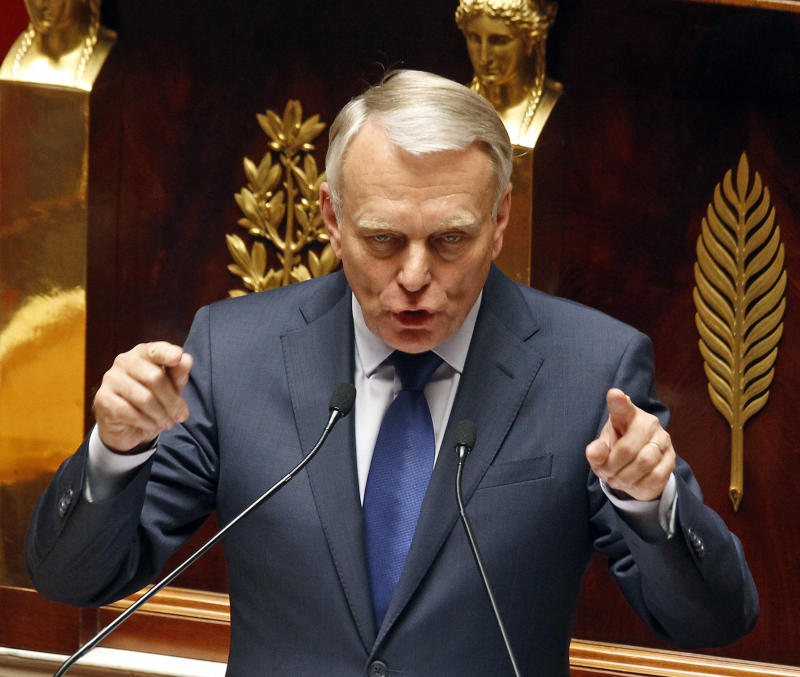 "French Prime Minister Jean-Marc Ayrault, delivers his first speech to the new Socialist-dominated parliament,  at the national Assembly in Paris, Tuesday July 3, 2012. France's new Socialist prime minister says the country's debts have become ""crushing,"" laying the groundwork for expected spending cuts and tax hikes.(AP Photo/Remy de la Mauviniere)"