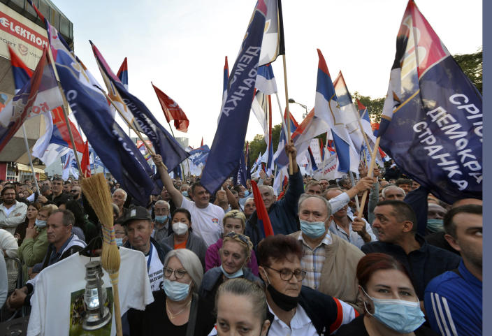 People gather for a protest against the government in Banja Luka, in Serb-dominated part of Bosnia, Saturday, Oct. 2, 2021. Several thousand people have rallied against the government in Serb-dominated part of Bosnia. The protesters on Saturday accused the ruling party of nationalist leader Milorad Dodik of crime and corruption and called for its ouster. (AP Photo/Radivoje Pavicic)
