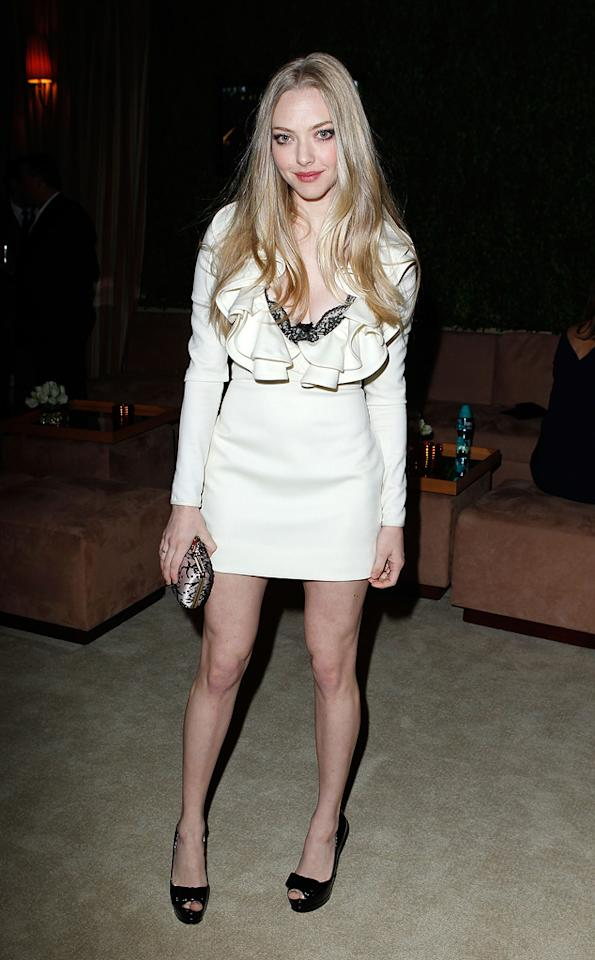 """Red Riding Hood's"" Amanda Seyfried channeled her inner vamp in a ruffled mini and black platform peep-toes."