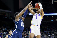 <p>LSU Tigers guard Javonte Smart (1) shoots the ball as Yale Bulldogs guard Miye Oni (25) defends in the first round of the 2019 NCAA Men's Basketball Tournament held at VyStar Veterans Memorial Arena on March 21, 2019 in Jacksonville, Florida. (Photo by Matt Marriott/NCAA Photos via Getty Images) </p>