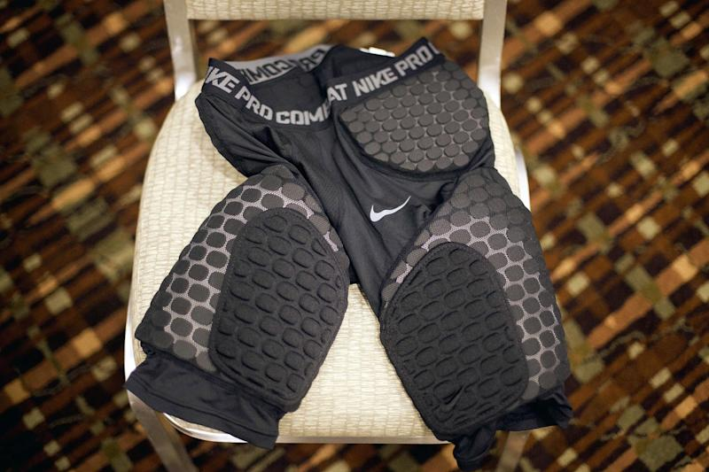 A sample of the new thigh pads the NFL made mandatory equipment for the 2013 football season sit on a chair following a news conference at an owners meeting, Tuesday, May 22, 2012, in Atlanta. (AP Photo/David Goldman)
