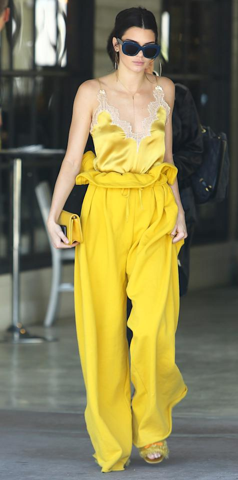 """<p>Even Kendall Jenner can't escape the <em>Beauty and the Beast </em><a rel=""""nofollow"""" href=""""http://www.instyle.com/celebrity/celebrities-channeling-belle-red-carpet"""">craze</a>. The model stepped out in California in a head-to-toe yellow look, from a silky lace cami to paperbag Kendall + Kylie sweatpants, furry slides, and a matching clutch. While the sweats are now sold out, you can shop more from Kendall + Kylie's line at <a rel=""""nofollow"""" href=""""https://click.linksynergy.com/fs-bin/click?id=93xLBvPhAeE&subid=0&offerid=390098.1&type=10&tmpid=8157&RD_PARM1=http%253A%252F%252Fshop.nordstrom.com%252Fc%252Fkendall-and-kylie-clothing-for-women%253Fcampaign%253D0201kendallkylieblp%2526mcamp%253D3188%2526cm_sp%253Dmerch-_-wshoe_0201kendallkylie_3188-_-brandlandingpage_shop2&u1=ISNEWSKendallKylie3.16OB"""">Nordstrom</a>.</p>"""