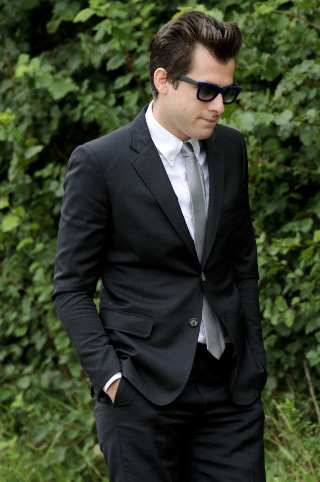 British producer Mark Ronson arrives at Edgwarebury Cemetery, in London, Tuesday July 26, 2011, to attend the funeral of singer Amy Winehouse. The soul diva, who had battled alcohol and drug addiction, was found dead Saturday at her London home. She was 27. (AP Photo/Jonathan Short)