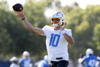 Los Angeles Chargers quarterback Justin Herbert throws a pass during practice at the NFL football team's training camp in Costa Mesa, Calif., Wednesday, July 28, 2021. (AP Photo/Alex Gallardo)