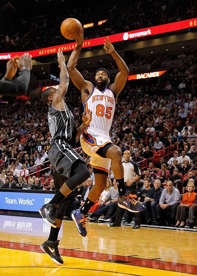 MIAMI, FL - FEBRUARY 23:  Baron Davis #85 of the New York Knicks passes over Norris Cole #30 of the Miami Heat during a game  at American Airlines Arena on February 23, 2012 in Miami, Florida. NOTE TO USER: User expressly acknowledges and agrees that, by downloading and/or using this Photograph, User is consenting to the terms and conditions of the Getty Images License Agreement.  (Photo by Mike Ehrmann/Getty Images)