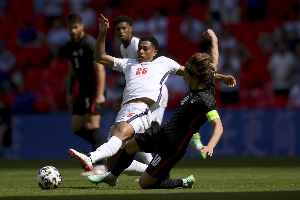 England's Jude Bellingham is challenged by Croatia's Luka Modric, right, during the Euro 2020 soccer championship group D match between England and Croatia, at Wembley stadium, London, Sunday, June 13, 2021. (Laurence Griffiths, Pool via AP)
