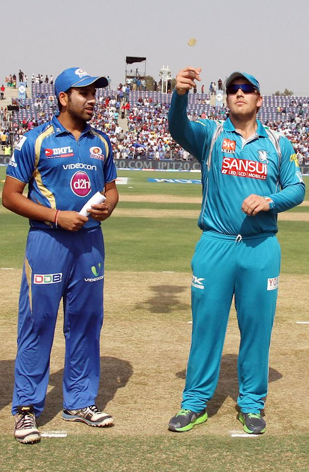 Mumbai Indian captain Rohit Sharma and Pune Warriors captain Aaron Finch during the toss of the match 58 of the Pepsi Indian Premier League ( IPL) 2013  between The Pune Warriors India and the Mumbai Indians held at the Subrata Roy Sahara Stadium, Pune on the 11th May 2013. (BCCI)