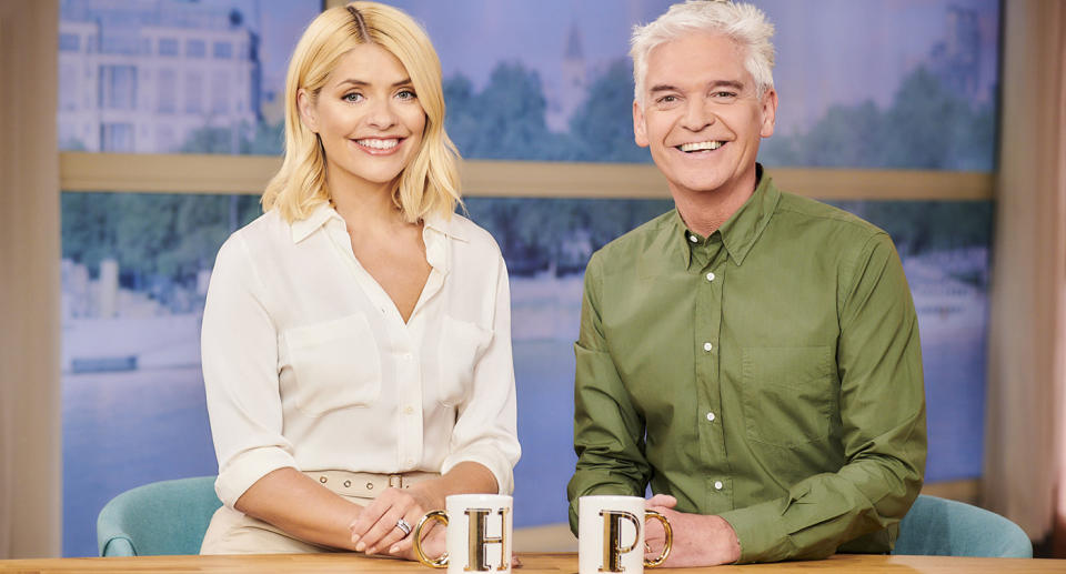 FROM ITV DAYTIME  THIS MORNING Weekdays on ITV   Pictured: Phillip Schofield and Holly Willoughby 'This Morning' TV show, London, UK -   © ITV   Photographer Joel Anderson  For further information please contact Peter Gray 0207 157 3046 peter.gray@itv.com    This photograph is © ITV and can only be reproduced for editorial purposes directly in connection with the  programme THIS MORNING or ITV. Once made available by the ITV Picture Desk, this photograph can be reproduced once only up until the Transmission date and no reproduction fee will be charged. Any subsequent usage may incur a fee. This photograph must not be syndicated to any other company, publication or website, or permanently archived, without the express written permission of ITV Picture Desk. Full Terms and conditions are available on  www.itv.com/presscentre/itvpictures/terms
