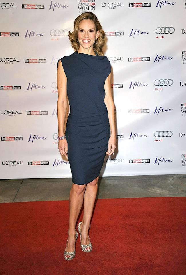 "At the same event, Oscar winner Hilary Swank followed suit in a chic and simple asymmetrical blue dress. John Shearer/<a href=""http://www.wireimage.com"" target=""new"">WireImage.com</a> - December 4, 2009"