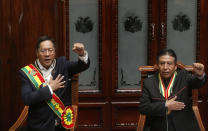 Bolivia's new President Luis Arce, left, and Vice President David Choquehuanca sing the national anthem on their inauguration day at Congress in La Paz, Bolivia, Sunday, Nov. 8, 2020. (AP Photo/Jorge Mamani)