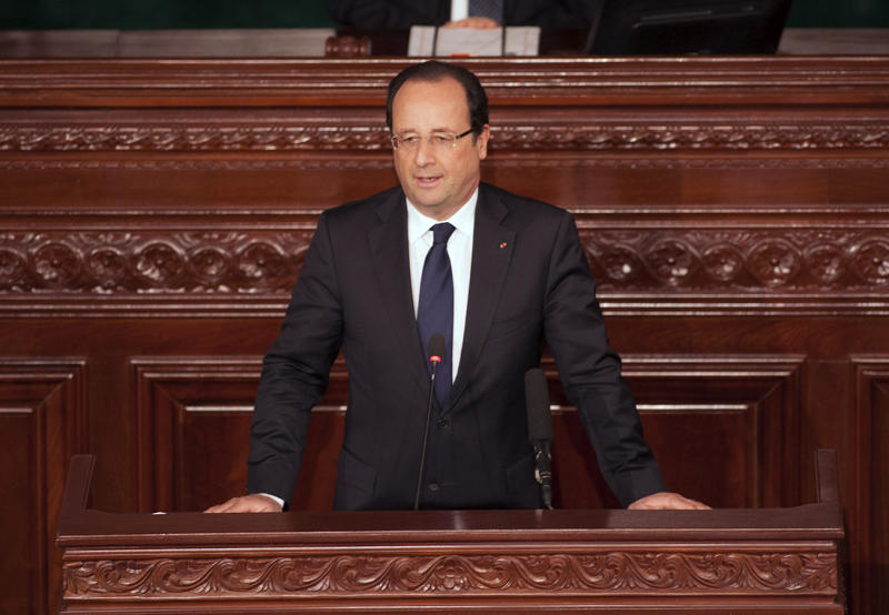 French President Francois Hollande delivers his speech at the Tunisian National Assembly in Tunis, Tunisia, Friday July 5, 2013. French President Francois Hollande is making his first visit to Tunisia seeking a new page in relations with the North African country that was the birthplace of the Arab Spring pro-democracy uprisings. (AP Photo/Amine Andoulsi)