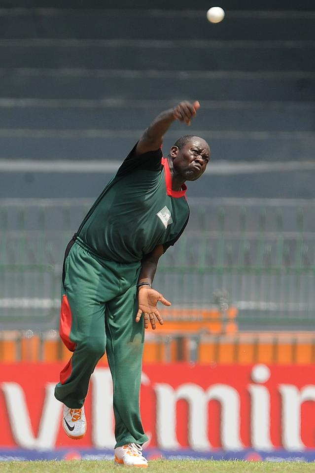 Kenyan cricketer Steve Tikolo delivers a ball  during a Cricket World Cup warm-up match between West Indies and Kenya at The R. Peremadasa Stadium in Colombo on February 12, 2011. Kenyan cricket team captain Jimmy Kamande won the toss and elected to field first. The 2011 Cricket World Cup event takes place in India, Sri Lanka and Bangladesh from February 19-April 2 with 14 nations taking part in the marathon six-week tournament. AFP PHOTO/Lakruwan WANNIARACHCHI