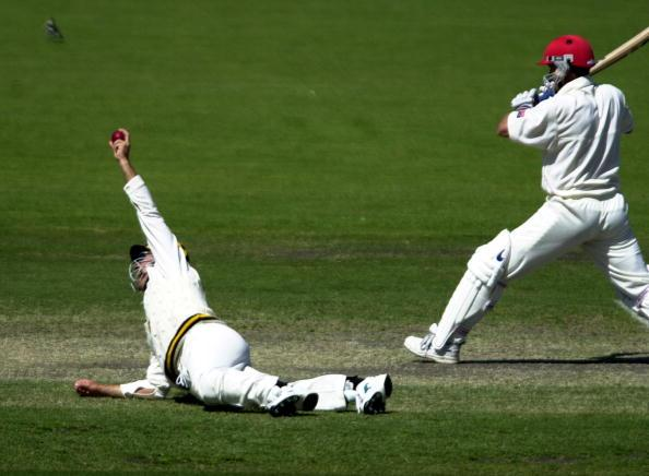 28 Oct 2000:  Justin Langer of Worriors catches Redback Brad young off the bowling of Tom Moody of Warriors for 14 in the Pura Cup Cricket match between the Western Warriors and the Southern Redbacks played at Adelaide Oval in Adelaide, Australia. DIGITAL IMAGE Mandatory Credit: Tony Lewis/ALLSPORT