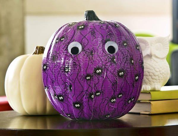 """<p>Carving with little kids can be challenging, especially if you've got more than one running around. This year, try using festive duct tape instead. Glue on some Googly eyes for a finishing touch.</p><p><strong>Get the tutorial at <a href=""""https://modpodgerocksblog.com/how-to-decorate-a-pumpkin/"""" rel=""""nofollow noopener"""" target=""""_blank"""" data-ylk=""""slk:Mod Podge Rocks"""" class=""""link rapid-noclick-resp"""">Mod Podge Rocks</a>.<br></strong></p>"""
