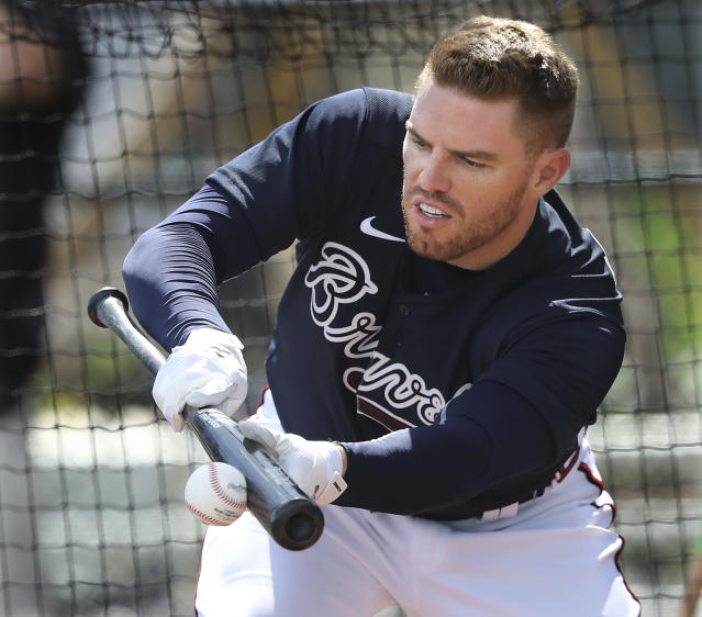 Atlanta Braves first baseman Freddie Freeman lays down a bunt during a spring training baseball practice in North Port, Fla., Tuesday, Feb. 18, 2020. (Curtis Compton/Atlanta Journal-Constitution via AP)