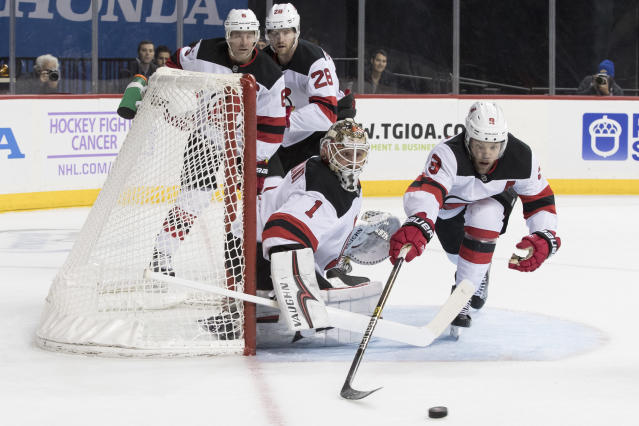 New Jersey Devils goaltender Keith Kinkaid (1) and left wing Taylor Hall (9) defend the net during the second period of an NHL hockey game against the New York Islanders, Saturday, Nov. 3, 2018, in New York. (AP Photo/Mary Altaffer)