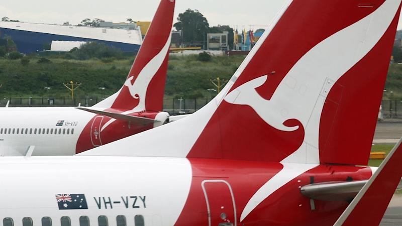 A man has been arrested after causing a disturbance on an overnight flight from Perth to Brisbane.