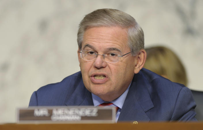 FILE - In this Sept. 4, 2013, file photo, Sen. Robert Menendez, D-N.J. speaks at Capitol Hill in Washington. Congress will weigh some of the most significant U.S. sanctions on Russia since the end of the Cold War in a bid to pressure President Vladimir Putin to pull Russian troops out of Crimea, according to a copy of a new Senate bill obtained by The Associated Press. Menendez, chairman of the Foreign Relations panel, introduced the legislation. (AP Photo/Susan Walsh, File)