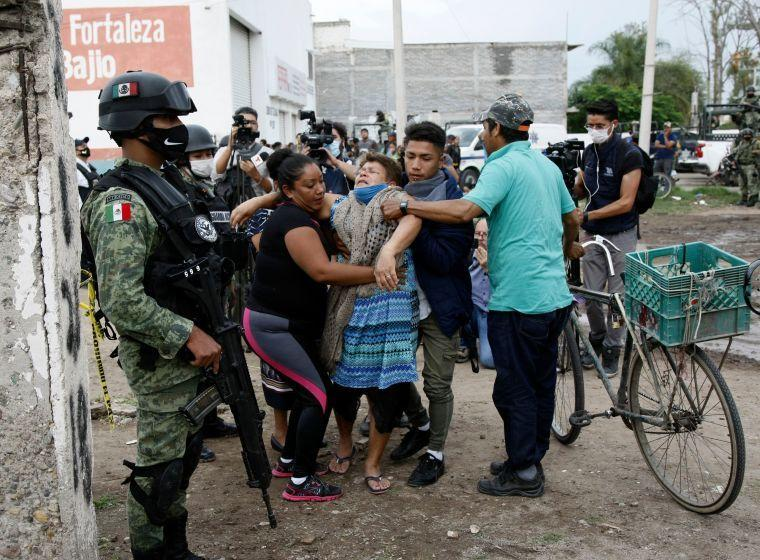 A woman reacts after 27 people were killed in Guanajuato, Mexico, on July 1. The attack was believed to be carried out by the Santa Rosa de Lima cartel, whose leader was arrested Sunday. (Mario Armas/AFP via Getty Images)