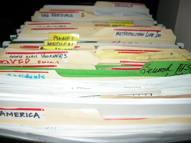 In this undated image released by Heather Brookes Interior Organization, various files are shown before a home office organization project. (AP Photo/Heather Brookes Interior Organization)
