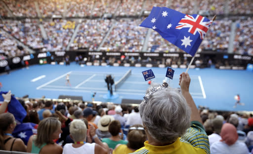 Australian fan cheers on Australia's Ashleigh Barty during her quarterfinal against Petra Kvitova of the Czech Republic at the Australian Open tennis championships in Melbourne, Australia, Tuesday, Jan. 22, 2019. (AP Photo/Mark Schiefelbein)