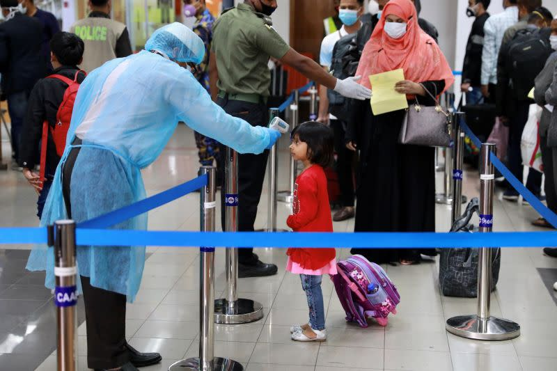A child is being checked with thermal scanner at the Hazrat Shahjalal International Airport as a preventive measure against coronavirus in Dhaka