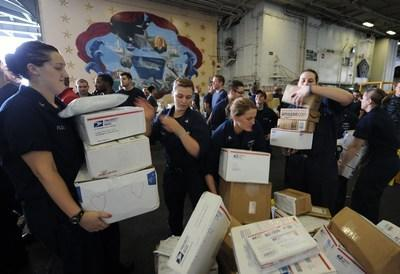Sailors sort boxes during a mail call aboard USS Dwight D. Eisenhower in the Arabian Sea. (U.S. Navy photo by Petty Officer 3rd Class Ryan D. McLearnon)