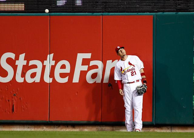 St. Louis Cardinals right fielder Allen Craig stands at the wall after he was unable to catch a two-run home run hit by Chicago Cubs' Luis Valbuena during the third inning of a baseball game Tuesday, May 13, 2014 , in St. Louis. (AP Photo/Scott Kane)