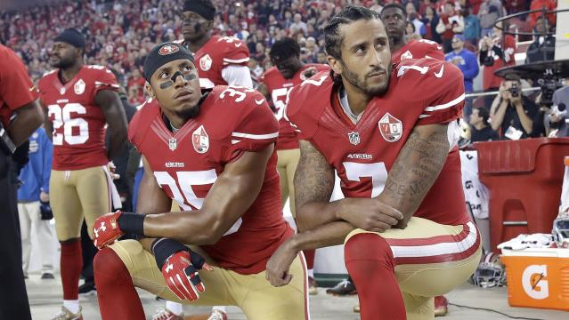 Eric Reid, left, and Colin Kaepernick kneel during the national anthem before an NFL game. (AP)